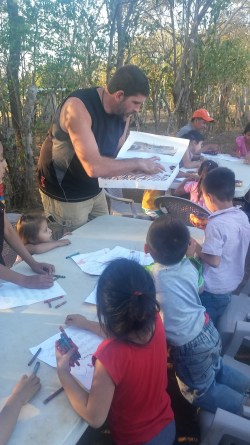 Phillip passing out donuts to the kids.