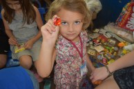 Olivia helping to find the best prizes at our children's ministry room during Med-Fest.