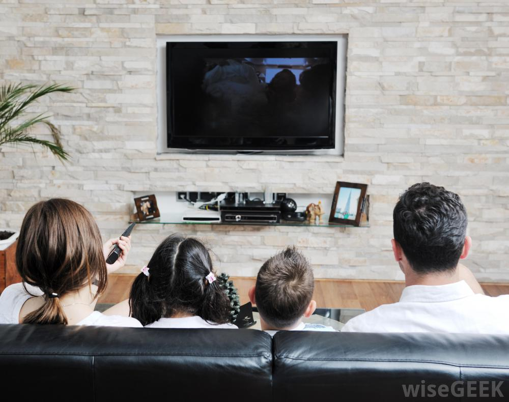 family-on-couch-watching-television