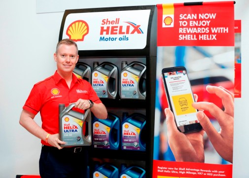 Shell Lubricants Exec Dir Troy Chapman with the new Shell Helix pack and SHARE