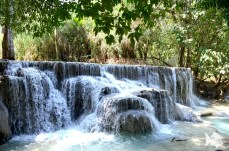 A single large cascade tumbles from the jungle feeding a series of falls creating natural swimming pools.
