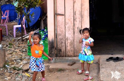 Laotian kids are always friendly with your camera