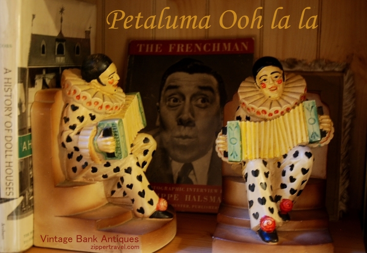 Vintage bookends of harlequins with squeezeboxes at Vintage Bank Antiques in Petaluma California