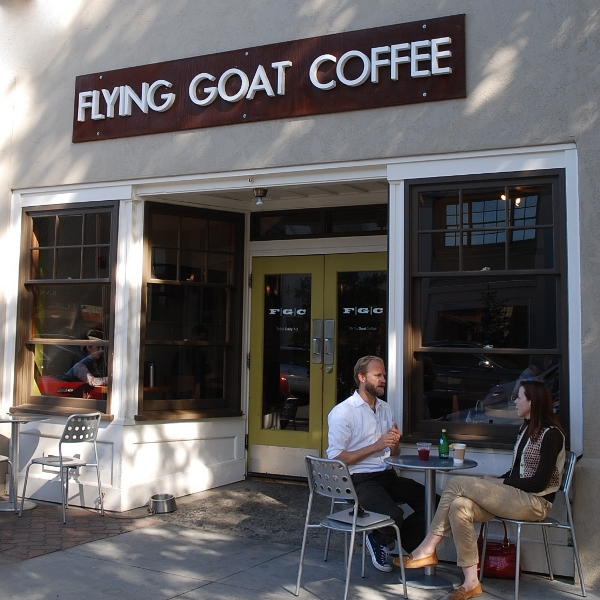 Man And Woman At Table Outside Flying Goat Coffee In Healdsburg California