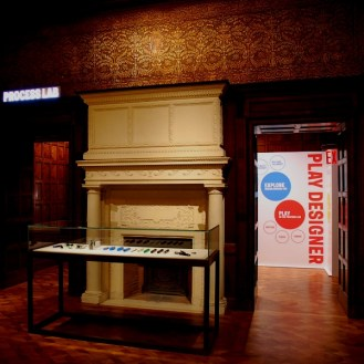 Foyer with fireplace and Play Design Room at the Cooper-Hewitt Museum