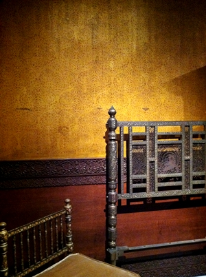 Bedframe and chair in the newly restored Teak Room at the Cooper-Hewitt