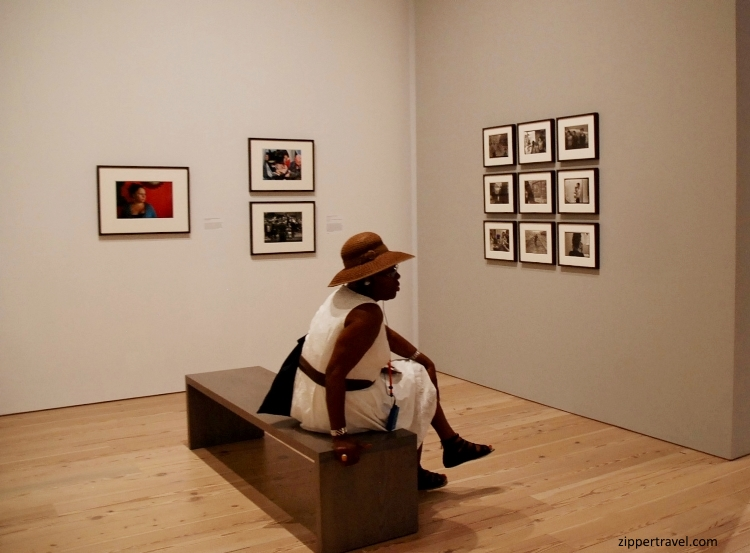 woman-seated-wearing-hat-whitney-museum