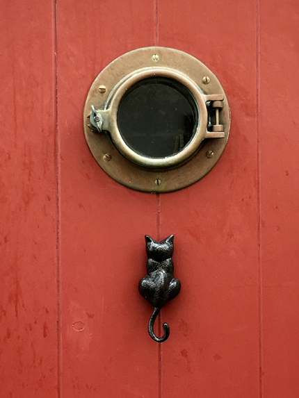 cat knocker porthole window fisherman's wharf victoria bc