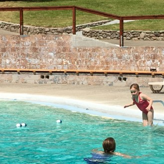 Morton Warm Springs little girl jumping Sonoma's Best Pools