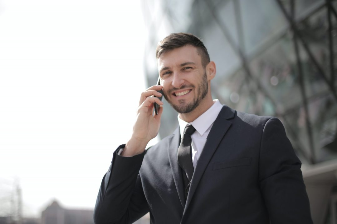 Business man in suit on phone