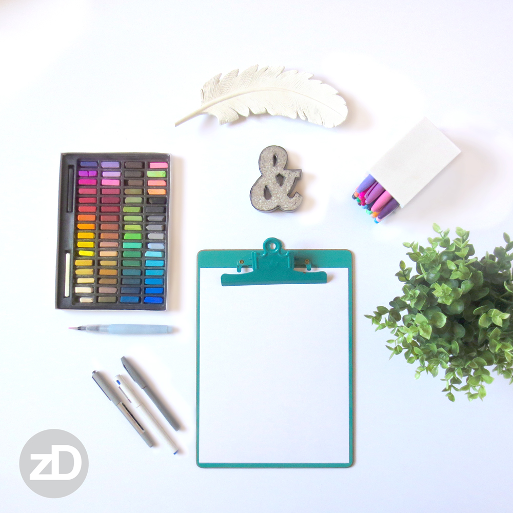 Zirkus Design | Photographing Flat Lay Product Mockups | Colored Pastels, Sharpie Markers, Plant, Pens, & Feather