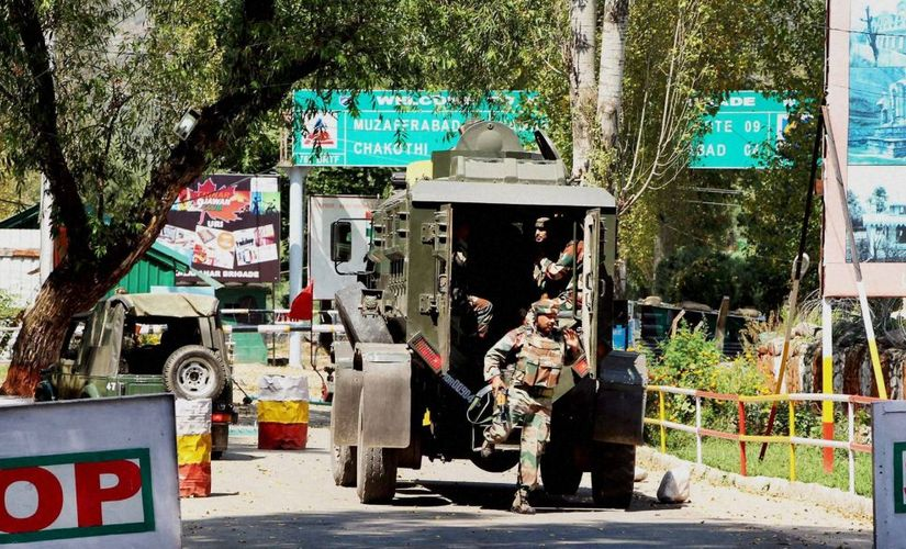 Army soldiers rush to the attack site in Uri.