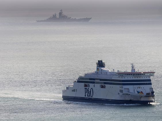 A Russian Naval vessel passes a ferry in the English channel