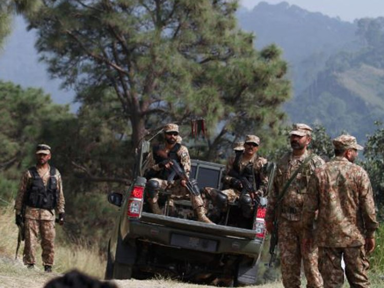 Pakistan army soldiers patrol at the forward area Bagsar post in Bhimber.