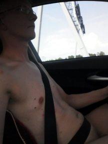Nude behind the wheel