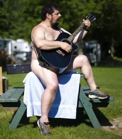 nude man playing guitar