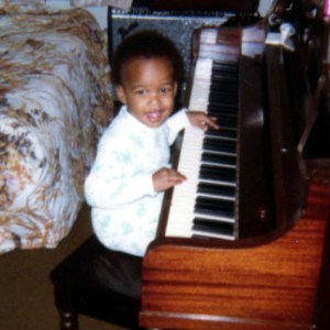 Me at age 2 banging on the piano at home.