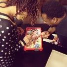 Carmen Rodgers and Phonte going in on a game of Operation (Oct. 2013)