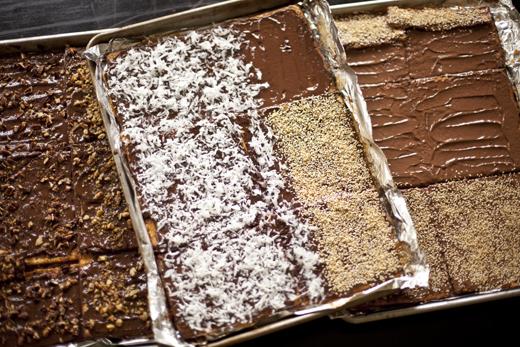 Adding toppings to your matzohs   Chocolate Caramel Matzo   Photo by Zoë François