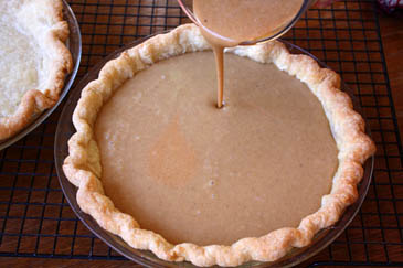 Pouring sweet potato pie filling into baked crust | ZoëBakes | Photo by Zoë François