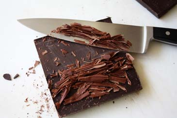 Shaving chocolate bar with chef's knife   ZoëBakes   Photo by Zoë François