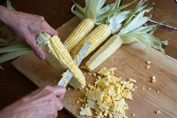 Removing corn kernels from cob with knife | ZoëBakes | Photo by Zoë François