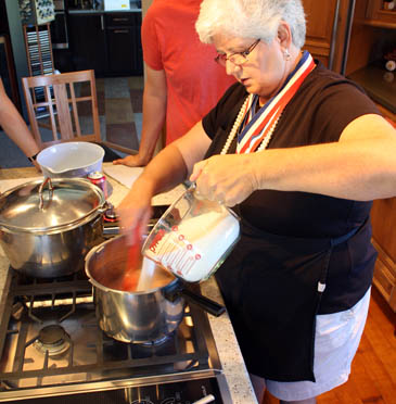 Barb Schaller adding sugar to her peach-raspberry jam