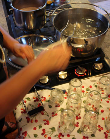 Sanitizing jam jars in boiling water