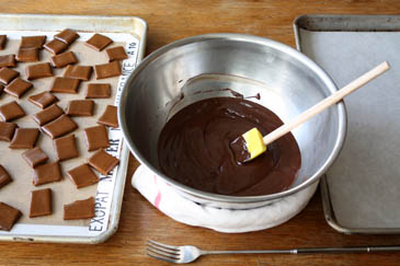 Toffee on baking sheet next to bowl of melted chocolate | ZoëBakes | Photo by Zoë François