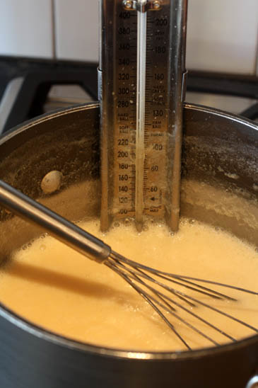 How to make fudge: boiling evaporated milk in a sauce pot with a candy thermometer