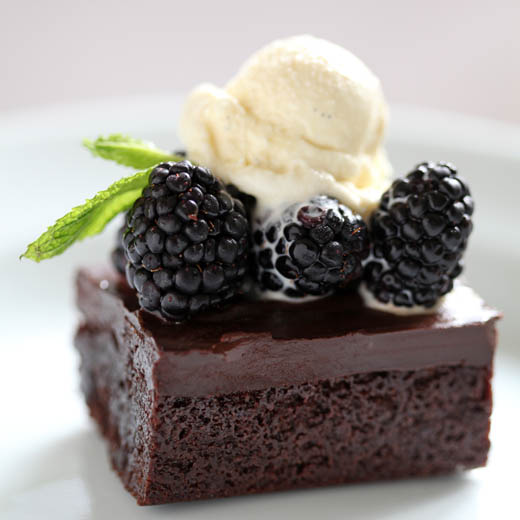 Gluten free chocolate brownie topped with blackberries and mint ice cream | ZoëBakes | Photo by Zoë François