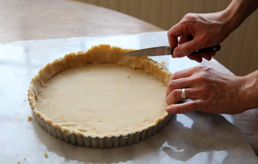 almond tart dough in a tart pan