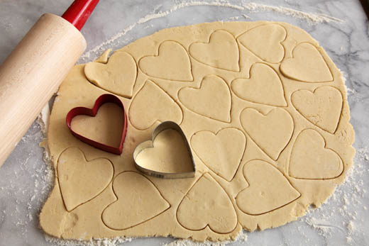 Cutting cookie dough with heart shaped cookie cutters | ZoëBakes | Photo by Zoë François