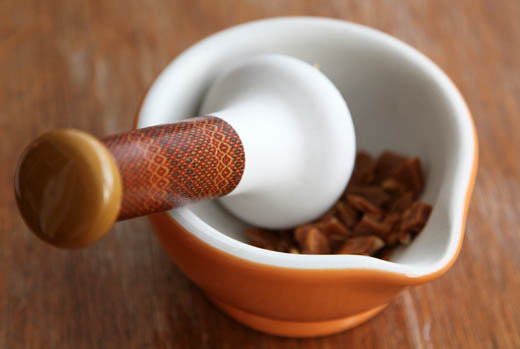 Crushing toffee with mortar and pestle | ZoëBakes | Photo by Zoë François