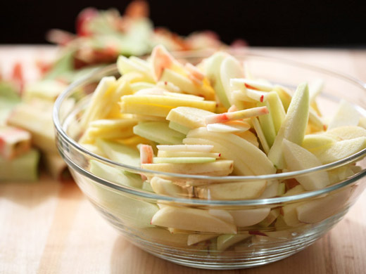 The best apple pie recipe - a bowl of peeled and sliced apples ready for the pie | photo by Zoë François