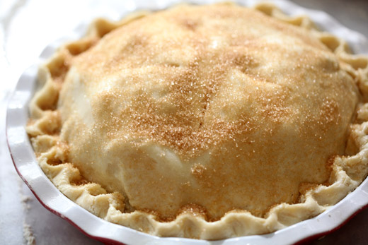 The best apple pie recipe - prepared pie with egg wash and turbinado sugar, ready for the oven | photo by Zoë François