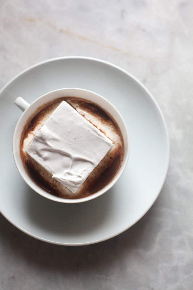 Square marshmallow in mug of hot cocoa | how to make homemade marshmallows | photo by Zoë François