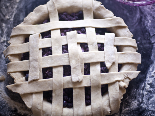 Blueberry Pie Recipe - lay out strips of dough over the blueberries | photo by Zoë François