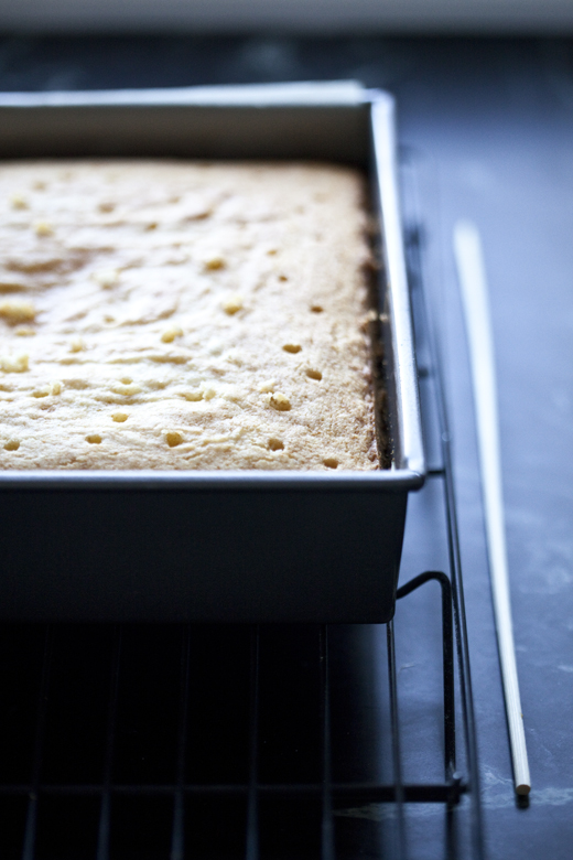 Poking holes in caramel Tres Leches | ZoëBakes | Photo by Zoë François
