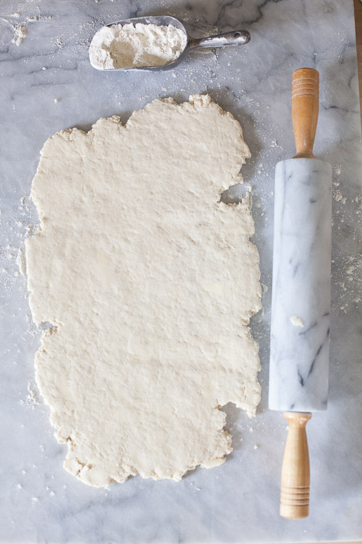 How to Make Flaky Biscuits | Rolling out the dough into a rectangle on a lightly floured surface
