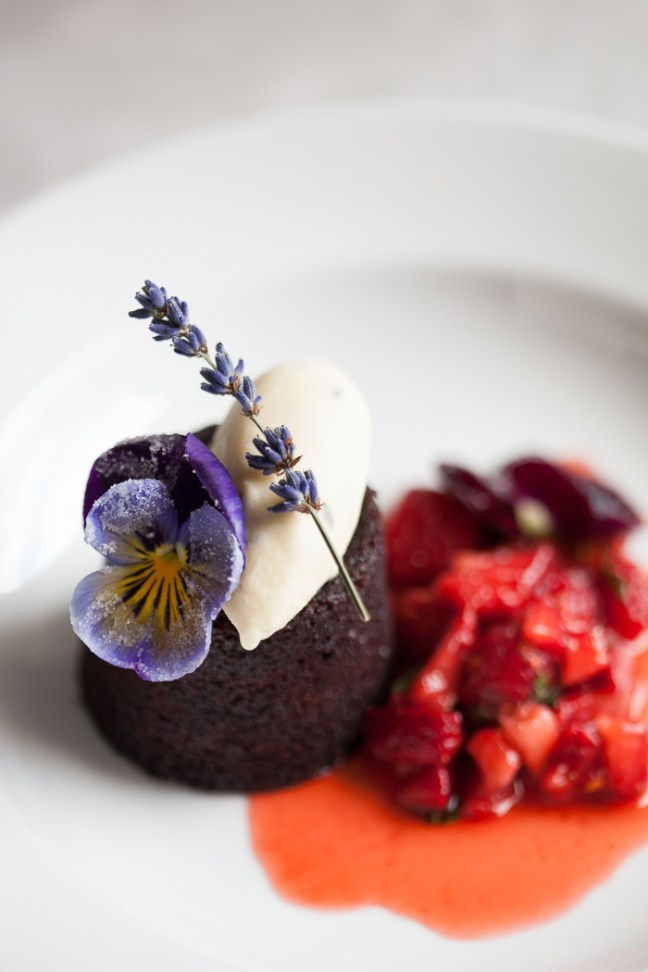 Chocolate Fudge Cake with Strawberry Salsa and Candied Flowers | ZoeBakes photo by Zoë François