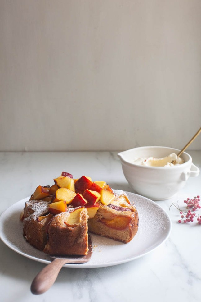 Peach Rye Cake with peaches piled on top | Photo by Zoë François | ZoeBakes