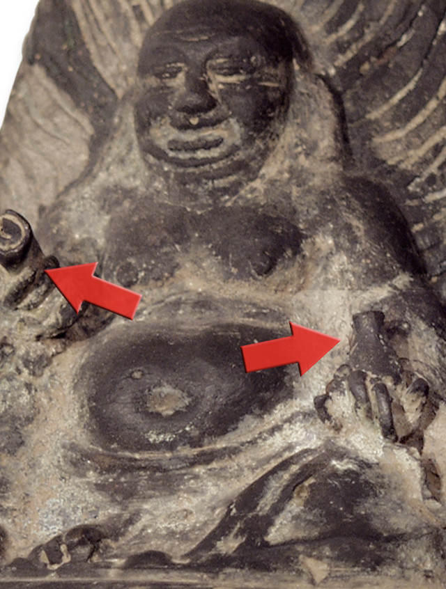 Closeup of the Buddha holding a Scroll and Medicine Jar