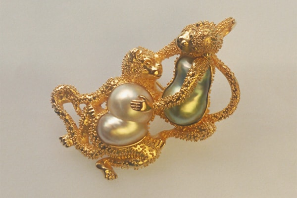 Fine Art Jewelry featuring a gold monkey pearl brooch. Symbol jewelry, inspired by the monkey. Photo by Zoein Jewels designer Shunyata