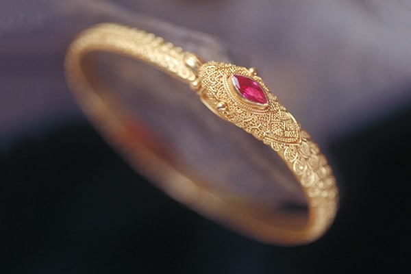 Fine Art Jewelry featuring a Gold and Ruby Serpent Bracelet. Photo by Zoein Jewels designer Shunyata