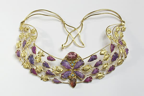 Inspired Symbol Jewelry featuring fine art jewelry the golden fish necklace. Photo by Zoein Jewels designer Shunyata
