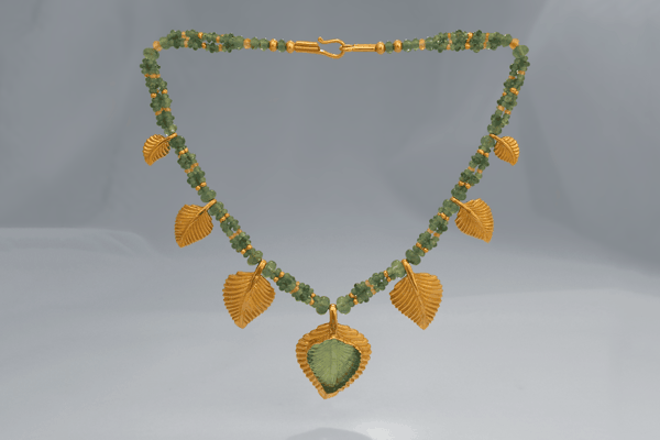 Fine Art Jewelry featuring the Emerald Leaf Necklace