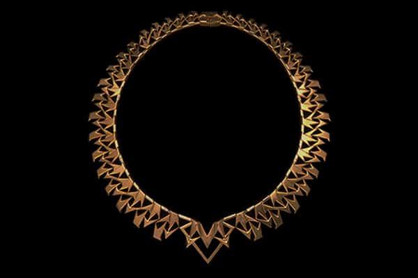 The Golden Yantra Necklace is sacred symbolic fine art jewelry based on the Sri Yantra