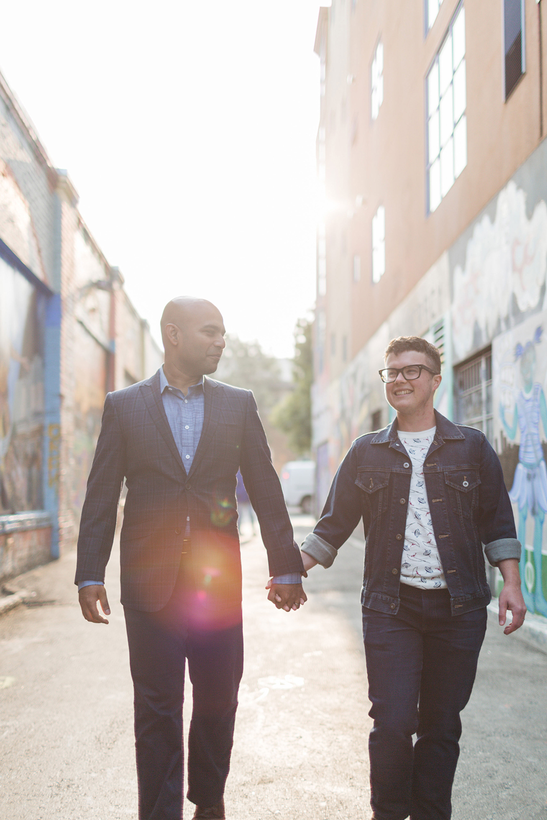 queer couples lgbt engaged walking and smiling in mission district sf