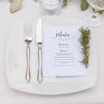 elegant white wedding place setting